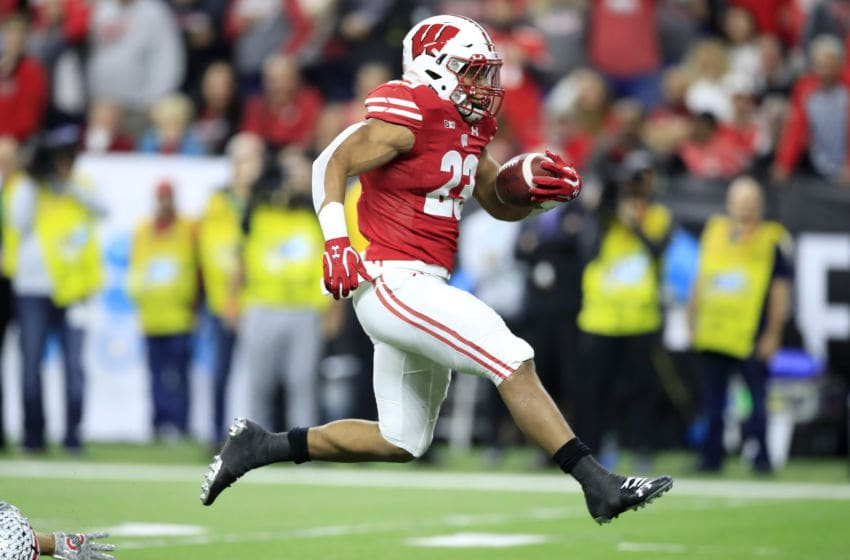 INDIANAPOLIS, INDIANA - DECEMBER 07: Jonathan Taylor #23 of the Wisconsin Badgers runs for a touchdown against the Ohio State Buckeyes during BIG Ten Football Championship Game2 at Lucas Oil Stadium on December 07, 2019 in Indianapolis, Indiana. (Photo by Andy Lyons/Getty Images)