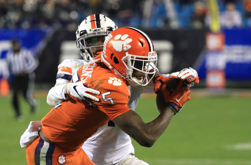 CHARLOTTE, NORTH CAROLINA - DECEMBER 07: Tee Higgins #5 of the Clemson Tigers makes a catch against Nick Grant #1 of the Virginia Cavaliers during the ACC Football Championship game at Bank of America Stadium on December 07, 2019 in Charlotte, North Carolina. (Photo by Streeter Lecka/Getty Images)