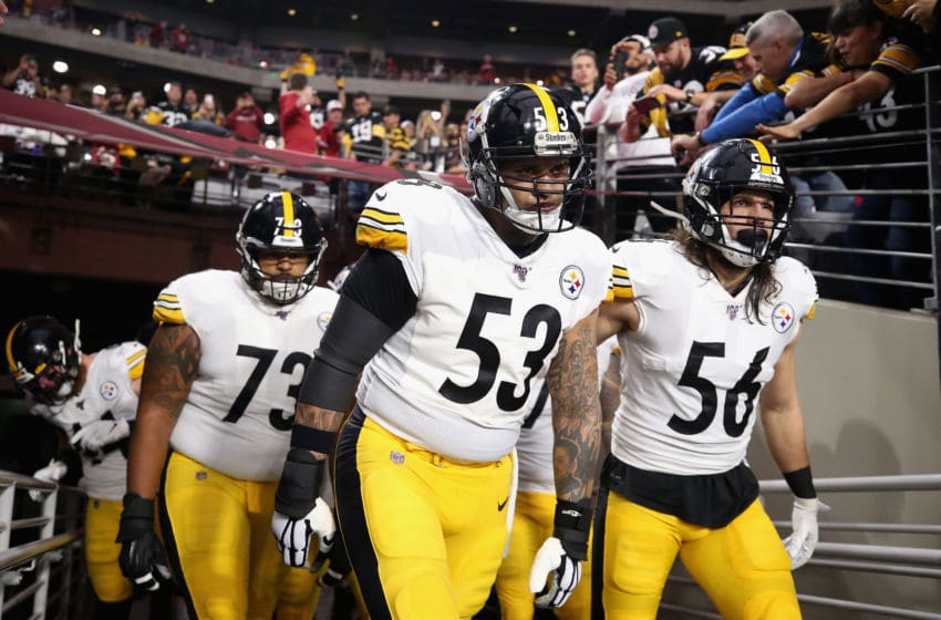 GLENDALE, ARIZONA - DECEMBER 08: Center Maurkice Pouncey #53 and linebacker Anthony Chickillo #56 of the Pittsburgh Steelers lead teammates onto the field before the NFL game against the Arizona Cardinals at State Farm Stadium on December 08, 2019 in Glendale, Arizona. The Steelers defeated the Cardinals 23-17. (Photo by Christian Petersen/Getty Images)