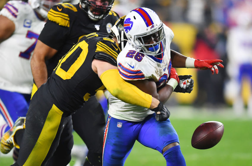 PITTSBURGH, PENNSYLVANIA - DECEMBER 15: T.J. Watt #90 of the Pittsburgh Steelers forces a fumble against Devin Singletary #26 of the Buffalo Bills during the third quarter in the game at Heinz Field on December 15, 2019 in Pittsburgh, Pennsylvania. (Photo by Joe Sargent/Getty Images)