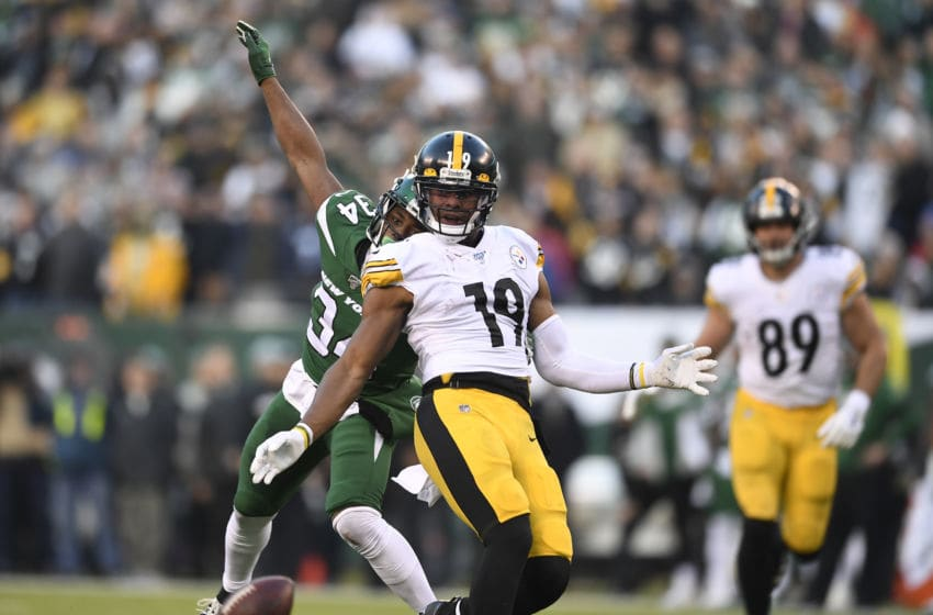 EAST RUTHERFORD, NEW JERSEY - DECEMBER 22: Brian Poole #34 of the New York Jets and JuJu Smith-Schuster #19 of the Pittsburgh Steelers watch as the pass to Smith-Schuster falls incomplete during the second half of the game at MetLife Stadium on December 22, 2019 in East Rutherford, New Jersey. The New York Jets won 16-10. (Photo by Sarah Stier/Getty Images)