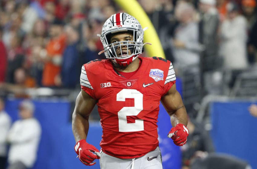GLENDALE, ARIZONA - DECEMBER 28: J.K. Dobbins #2 of the Ohio State Buckeyes celebrates after her runs the ball for 68-yard a touchdown against the Clemson Tigers in the first half during the College Football Playoff Semifinal at the PlayStation Fiesta Bowl at State Farm Stadium on December 28, 2019 in Glendale, Arizona. (Photo by Ralph Freso/Getty Images)