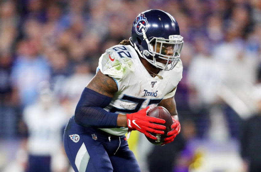 BALTIMORE, MARYLAND - JANUARY 11: Derrick Henry #22 of the Tennessee Titans handles the ball during the second half against the Baltimore Ravens in the AFC Divisional Playoff game at M&T Bank Stadium on January 11, 2020 in Baltimore, Maryland. (Photo by Maddie Meyer/Getty Images)