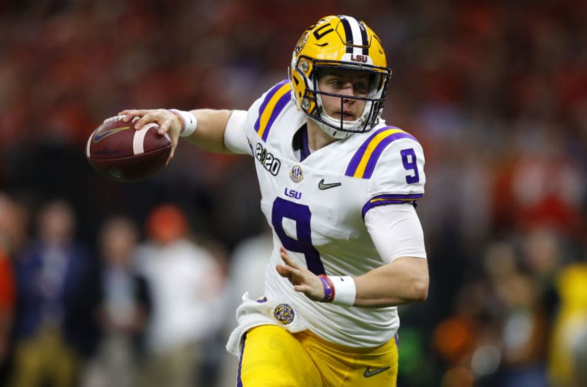 NEW ORLEANS, LOUISIANA - JANUARY 13: Joe Burrow #9 of the LSU Tigers throws the ball under pressure against the Clemson Tigers during the College Football Playoff National Championship game at Mercedes Benz Superdome on January 13, 2020 in New Orleans, Louisiana. (Photo by Jonathan Bachman/Getty Images)