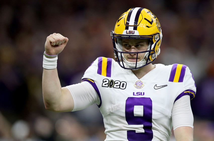 NEW ORLEANS, LOUISIANA - JANUARY 13: Joe Burrow #9 of the LSU Tigers reacts to a touchdown against Clemson Tigers during the third quarter in the College Football Playoff National Championship game at Mercedes Benz Superdome on January 13, 2020 in New Orleans, Louisiana. (Photo by Chris Graythen/Getty Images)