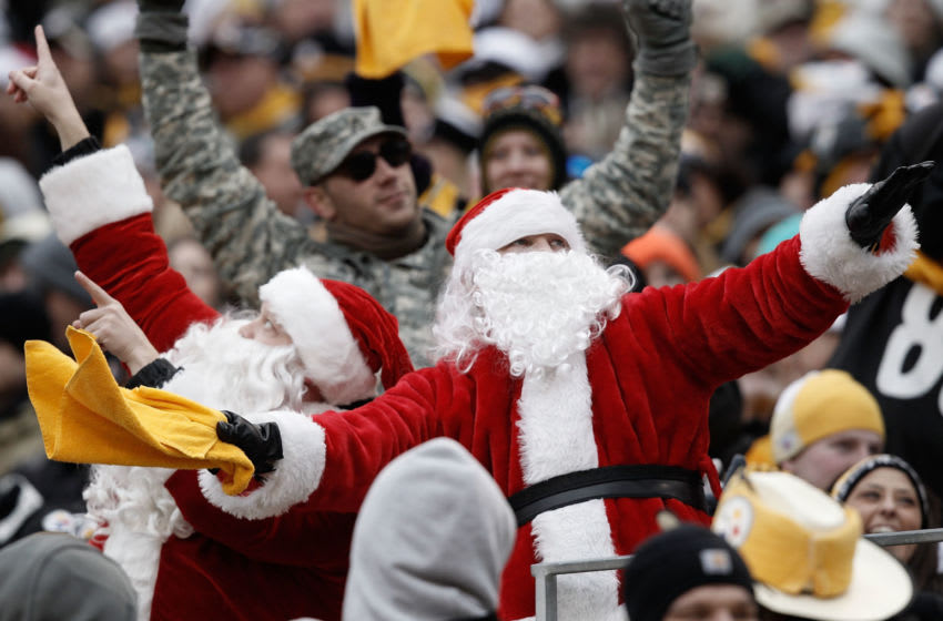 PITTSBURGH, PA - DECEMBER 24: Fans dressed as Santa Claus cheer during the Christmas Eve game between the Pittsburgh Steelers and the St. Louis Rams on December 24, 2011 at Heinz Field in Pittsburgh, Pennsylvania. (Photo by Jared Wickerham/Getty Images)