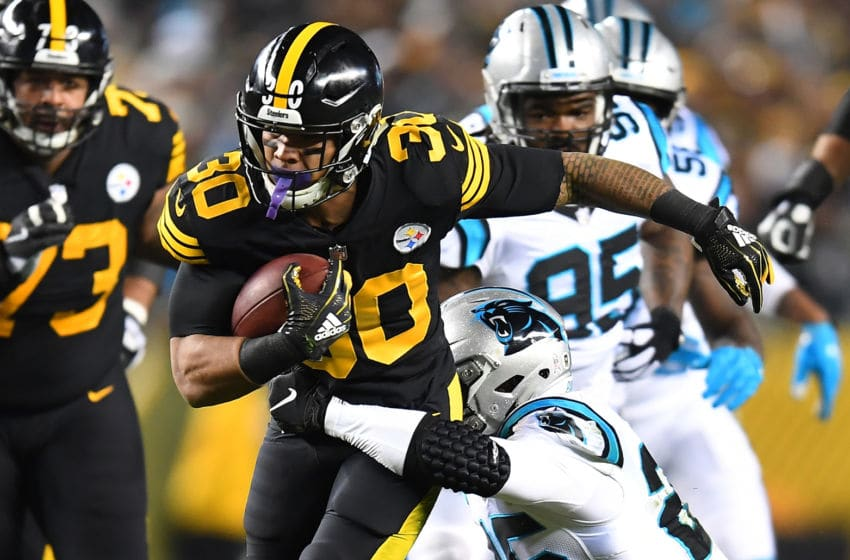 PITTSBURGH, PA - NOVEMBER 08: James Conner #30 of the Pittsburgh Steelers carries the ball against Eric Reid #25 of the Carolina Panthers during the first half in the game at Heinz Field on November 8, 2018 in Pittsburgh, Pennsylvania. (Photo by Joe Sargent/Getty Images)