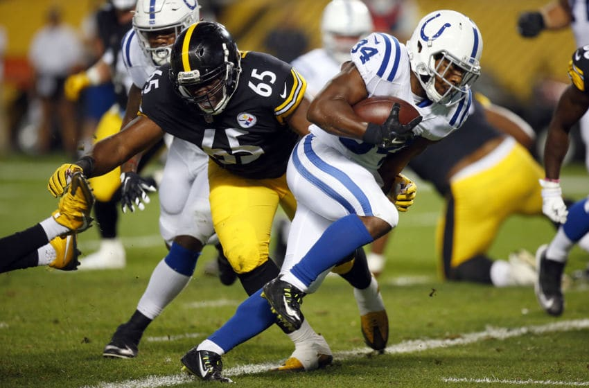 PITTSBURGH, PA - AUGUST 26: Josh Ferguson #34 of the Indianapolis Colts rushes for a 1 yard touchdown in the fourth quarter against Jerald Hawkins #65 of the Pittsburgh Steelers during a preseason game on August 26, 2017 at Heinz Field in Pittsburgh, Pennsylvania. (Photo by Justin K. Aller/Getty Images)