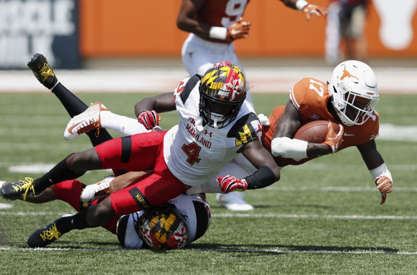 AUSTIN, TX - SEPTEMBER 02: Reggie Hemphill-Mapps #17 of the Texas Longhorns is tackled by Darnell Savage Jr. #4 of the Maryland Terrapins in the third quarter at Darrell K Royal-Texas Memorial Stadium on September 2, 2017 in Austin, Texas. (Photo by Tim Warner/Getty Images)