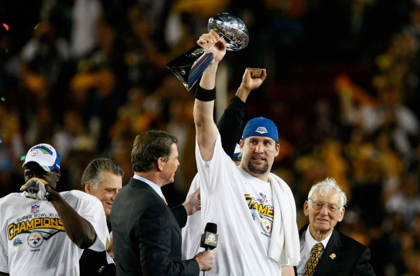 TAMPA, FL - FEBRUARY 01: Quarterback Ben Roethlisberger #7 of the Pittsburgh Steelers celebrates with the Vince Lombardi Trophy after the Steelers won 27-23 against the Arizona Cardinals during Super Bowl XLIII on February 1, 2009 at Raymond James Stadium in Tampa, Florida. (Photo by Win McNamee/Getty Images)