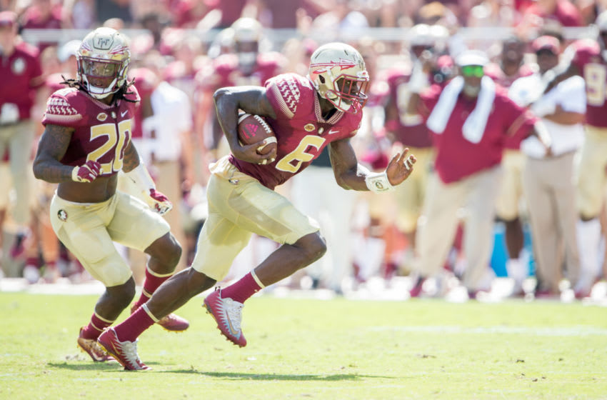 TALLAHASSEE, FL - OCTOBER 21: Linebacker Matthew Thomas #6 of the Florida State Seminoles runs the ball downfield after recovering a fumble during their game against the Louisville Cardinals at Doak Campbell Stadium on October 21, 2017 in Tallahassee, Florida. (Photo by Michael Chang/Getty Images)