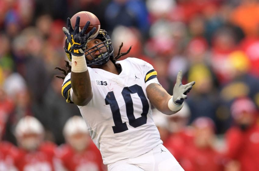 MADISON, WI - NOVEMBER 18: Devin Bush #10 of the Michigan Wolverines intercepts a pass during the third quarter of a game against the Wisconsin Badgers at Camp Randall Stadium on November 18, 2017 in Madison, Wisconsin. (Photo by Stacy Revere/Getty Images)
