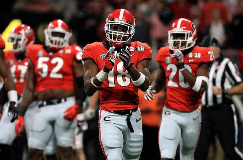 ATLANTA, GA - JANUARY 08: Deandre Baker #18 of the Georgia Bulldogs celebrates a play during the second quarter against the Alabama Crimson Tide in the CFP National Championship presented by AT&T at Mercedes-Benz Stadium on January 8, 2018 in Atlanta, Georgia. (Photo by Mike Ehrmann/Getty Images)