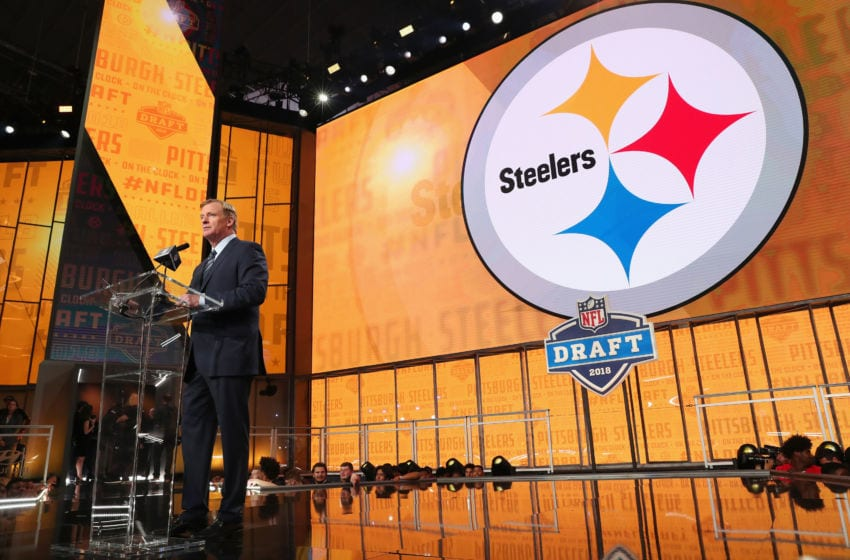 ARLINGTON, TX - APRIL 26: NFL Commissioner Roger Goodell announces a pick by the Pittsburgh Steelers during the first round of the 2018 NFL Draft at AT&T Stadium on April 26, 2018 in Arlington, Texas. (Photo by Tom Pennington/Getty Images)