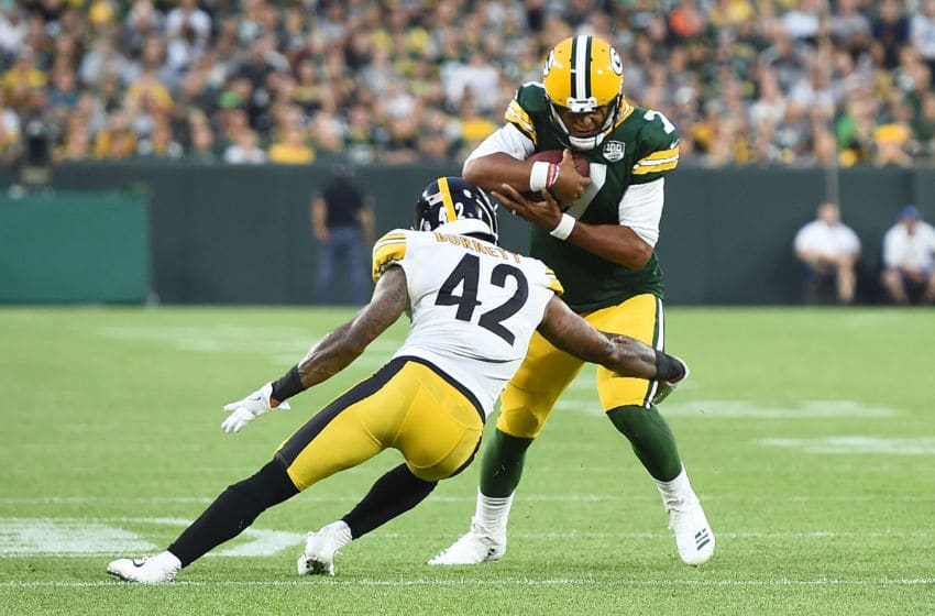 GREEN BAY, WI - AUGUST 16: Brett Hundley #7 of the Green Bay Packers is brought down by Morgan Burnett #42 of the Pittsburgh Steelers during the first quarter of a preseason game at Lambeau Field on August 16, 2018 in Green Bay, Wisconsin. (Photo by Stacy Revere/Getty Images)