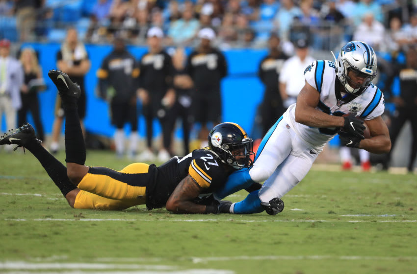 CHARLOTTE, NORTH CAROLINA - AUGUST 29: Marcus Allen #27 of the Pittsburgh Steelers tackles Reggie Bonnafon #39 of the Carolina Panthers during their preseason game at Bank of America Stadium on August 29, 2019 in Charlotte, North Carolina. (Photo by Streeter Lecka/Getty Images)
