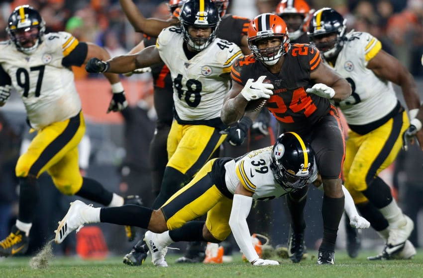 CLEVELAND, OH - NOVEMBER 14: Minkah Fitzpatrick #39 of the Pittsburgh Steelers attempts to tackle Nick Chubb #24 of the Cleveland Browns during the fourth quarter at FirstEnergy Stadium on November 14, 2019 in Cleveland, Ohio. Cleveland defeated Pittsburgh 21-7. (Photo by Kirk Irwin/Getty Images)