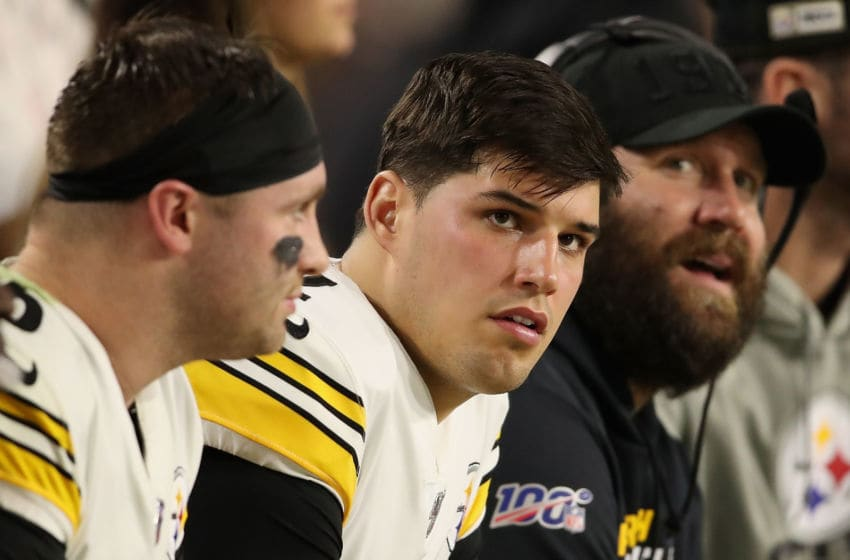 GLENDALE, ARIZONA - DECEMBER 08: Quarterback Mason Rudolph #2 (C) of the Pittsburgh Steelers sits alongside Devlin Hodges (L) and Ben Roethlisberger (R) during the second half of the NFL game against the Arizona Cardinals at State Farm Stadium on December 08, 2019 in Glendale, Arizona. The Steelers defeated the Cardinals 23-17. (Photo by Christian Petersen/Getty Images)