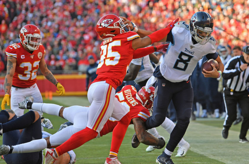 KANSAS CITY, MO - JANUARY 19: Quarterback Marcus Mariota #8 of the Tennessee Titans gets pushed out of bounds near the goal line by cornerback Charvarius Ward #35 of the Kansas City Chiefs, in the first half of the AFC Championship Game at Arrowhead Stadium on January 19, 2020 in Kansas City, Missouri. (Photo by Peter G. Aiken/Getty Images)