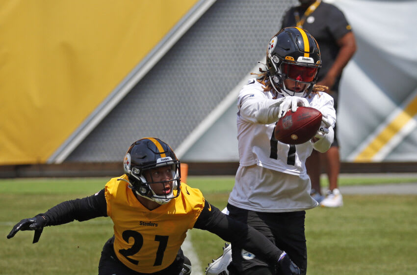 Chase Claypool #11 of the Pittsburgh Steelers and Tre Norwood #21 of the Pittsburgh Steelers (Photo by Justin K. Aller/Getty Images)