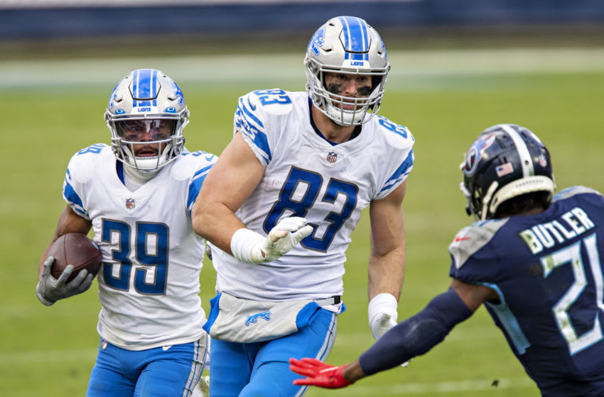 NASHVILLE, TENNESSEE - Running back Jamal Agnew #39 runs behind the blocking of tight end Jesse James #83 of the Detroit Lions during a game against the Tennessee Titans at Nissan Stadium on December 20, 2020 in Nashville, Tennessee. The Titans defeated the Lions 46-25. (Photo by Wesley Hitt/Getty Images)