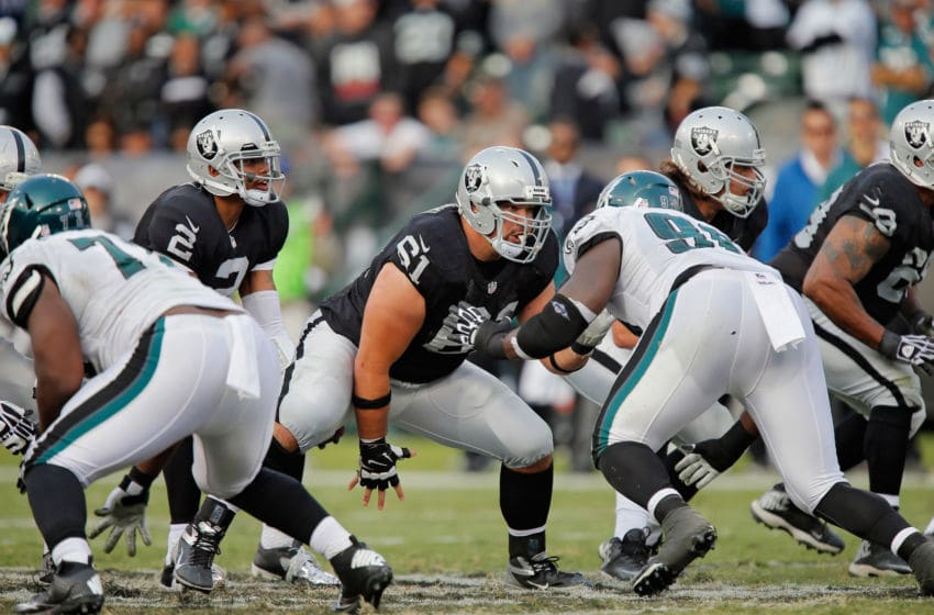 OAKLAND, CA - NOVEMBER 03: Center Stefan Wisniewski #61 of the Oakland Raiders snaps the ball against the Philadelphia Eagles in the third quarter on November 3, 2013 at O.co Coliseum in Oakland, California. The Eagles won 49-20. (Photo by Brian Bahr/Getty Images)