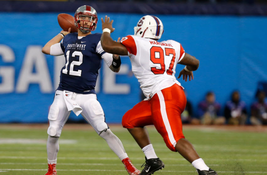 ST. PETERSBURG, FL - JANUARY 23: Brandon Doughty #12 from Western Kentucky playing on the West Team looks to throw over Javon Hargrave #97 from South Carolina State playing on the East Team during the first half of the East West Shrine Game at Tropicana Field on January 23, 2016 in St. Petersburg, Florida. (Photo by Mike Carlson/Getty Images)