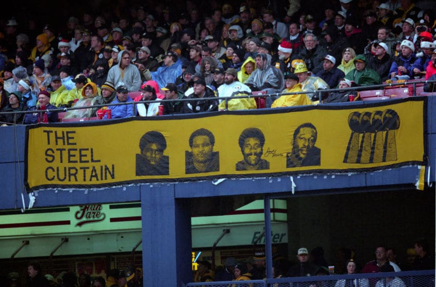 PITTSBURGH - DECEMBER 16: A sign for the Steel Curtain, (a name given to the defensive line of the Pittsburgh Steelers in the 1970s) from left, Dwight White, Ernie Holmes, Joe Greene and L.C. Greenwood, hangs from the stands during a game against the Washington Redskins at Three Rivers Stadium on December 16, 2000 in Pittsburgh, Pennsylvania. (Photo by George Gojkovich/Getty Images)