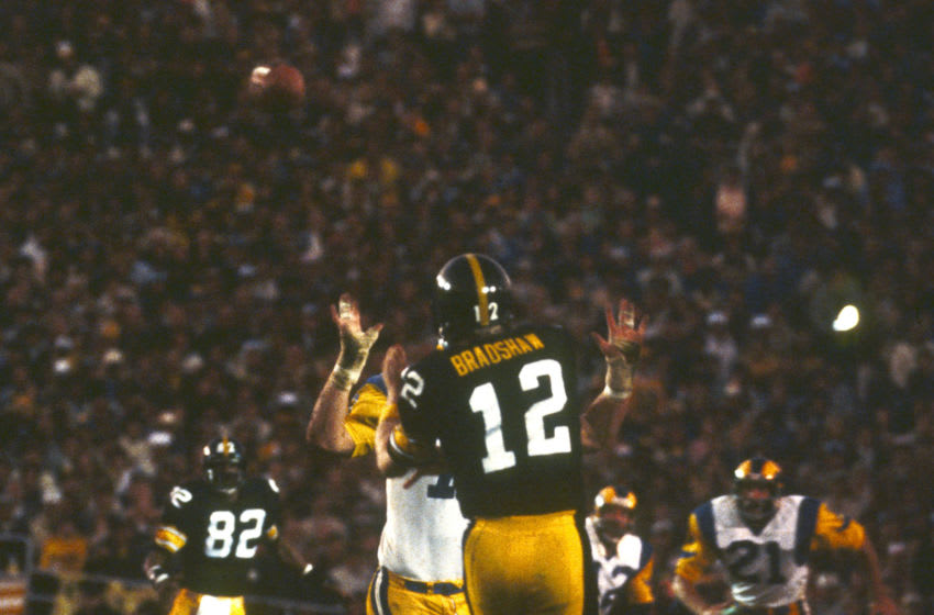 Pittsburgh Steelers Hall of Fame quarterback terry Bradshaw makes a pass to Hall of Fame wide receiver John Stallworth that was almost intercepted by Los Angeles Rams safety Noland Cromwell in a 31-19 win over the Los Angeles Rams in Super Bowl XIV on January 20, 1980 at Rose Bowl. (Photo by Nate Fine/Getty Images)