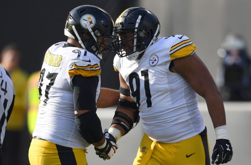 OAKLAND, CA - DECEMBER 09: Cameron Heyward #97 and Stephon Tuitt #91 of the Pittsburgh Steelers celebrates after they sacked quarterback Derek Carr #4 of the Oakland Raiders during the first half of their NFL football game at Oakland-Alameda County Coliseum on December 9, 2018 in Oakland, California. (Photo by Thearon W. Henderson/Getty Images)