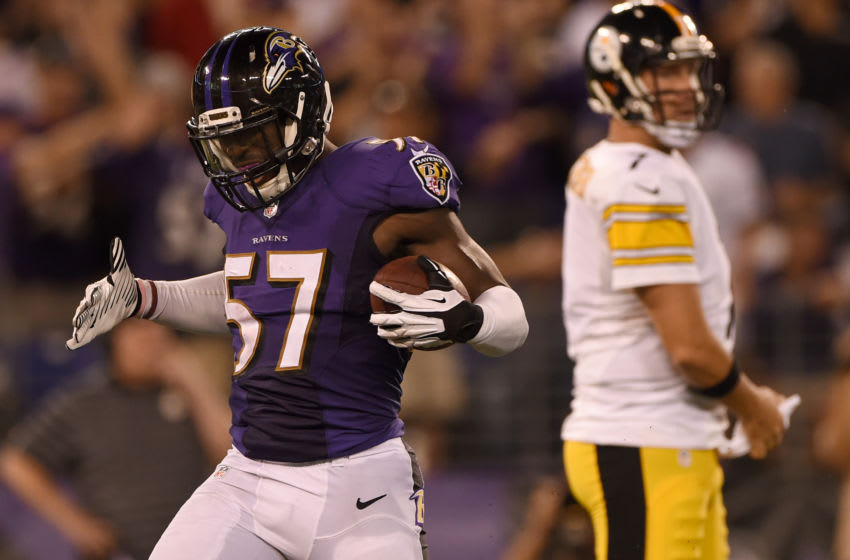 BALTIMORE, MD - SEPTEMBER 11: Inside linebacker C.J. Mosley #57 of the Baltimore Ravens celebrates his fumble recovery in the 4th quarter against the Pittsburgh Steelers at M&T Bank Stadium on September 11, 2014 in Baltimore, Maryland. (Photo by Patrick Smith/Getty Images)