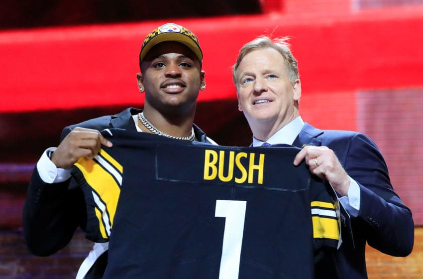 NASHVILLE, TENNESSEE - APRIL 25: Devin Bush of Michigan poses with NFL Commissioner Roger Goodell after being chosen #10 overall by the Pittsburgh Steelers during the first round of the 2019 NFL Draft on April 25, 2019 in Nashville, Tennessee. (Photo by Andy Lyons/Getty Images)