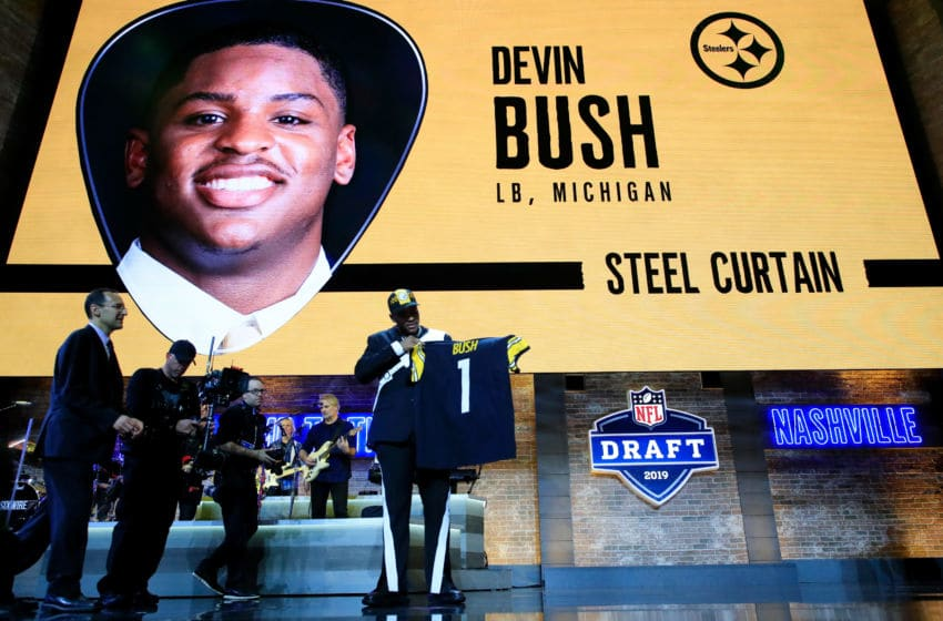 NASHVILLE, TENNESSEE - APRIL 25: Devin Bush of Michigan reacts after being chosen #10 overall by the Pittsburgh Steelers during the first round of the 2019 NFL Draft on April 25, 2019 in Nashville, Tennessee. (Photo by Andy Lyons/Getty Images)