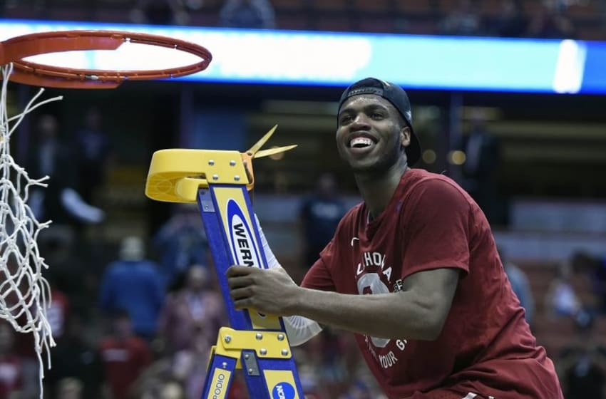 March 26, 2016; Anaheim, CA, USA; Oklahoma Sooners guard Buddy Hield (24) cuts the net and celebrates the 80-68 victory against Oregon Ducks to win the West regional final of the NCAA Tournament at Honda Center. Mandatory Credit: Richard Mackson-USA TODAY Sports