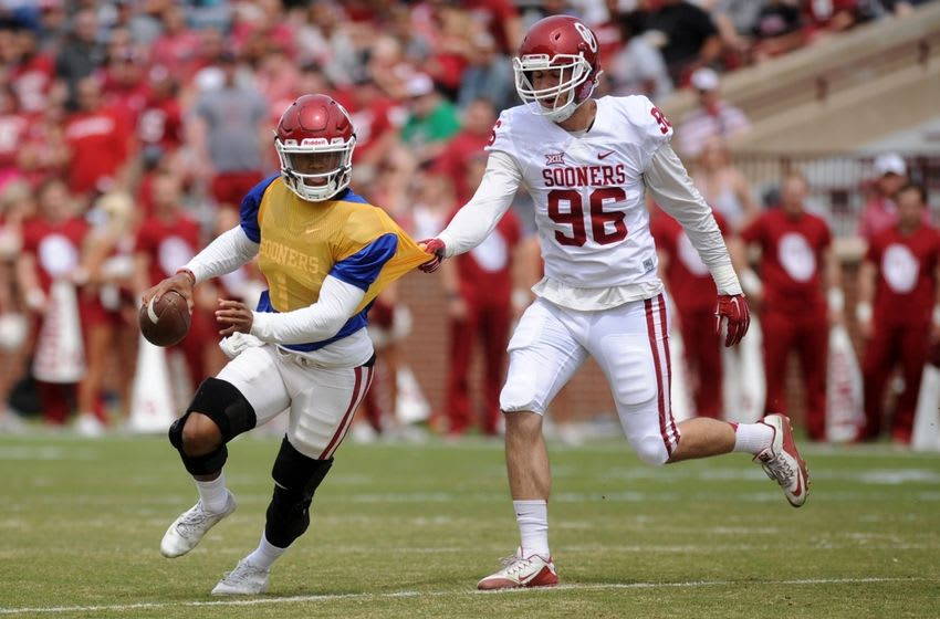 Apr 9, 2016; Norman, OK, USA; Oklahoma Sooners linebacker Dalton Rodriquez (96) grabs the jersey of Sooners quarterback Kyler Murray (1) during the first half of the spring game at Oklahoma Memorial Stadium. Mandatory Credit: Mark D. Smith-USA TODAY Sports