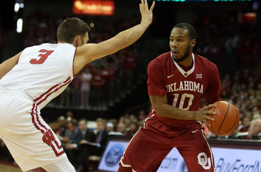 Dec 3, 2016; Madison, WI, USA; Oklahoma Sooners guard Jordan Woodard (10) looks to pass as Wisconsin Badgers guard Zak Showalter (3) defends during the first half at Kohl Center. Mandatory Credit: Mary Langenfeld-USA TODAY Sports