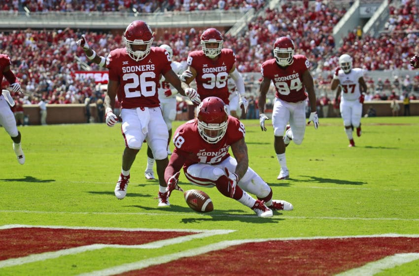 NORMAN, OK - SEPTEMBER 01: Linebacker Curtis Bolton #18 of the Oklahoma Sooners recovers a blocked punt to score against the Florida Atlantic Owls at Gaylord Family Oklahoma Memorial Stadium on September 1, 2018 in Norman, Oklahoma. (Photo by Brett Deering/Getty Images)