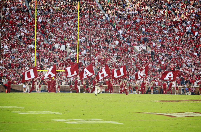 NORMAN, OK - SEPTEMBER 22: Members of the Oklahoma Sooners spirit squad celebrate a touchdown against the Army Black Knights at Gaylord Family Oklahoma Memorial Stadium on September 22, 2018 in Norman, Oklahoma. The Sooners defeated the Black Knights 28-21 in overtime. (Photo by Brett Deering/Getty Images)