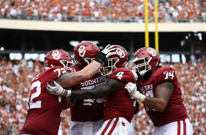 DALLAS, TX - OCTOBER 06: Trey Sermon #4 of the Oklahoma Sooners celebrates a touchdown against the Texas Longhorns in the fourth quarter of the 2018 AT&T Red River Showdown at Cotton Bowl on October 6, 2018 in Dallas, Texas. (Photo by Ronald Martinez/Getty Images)