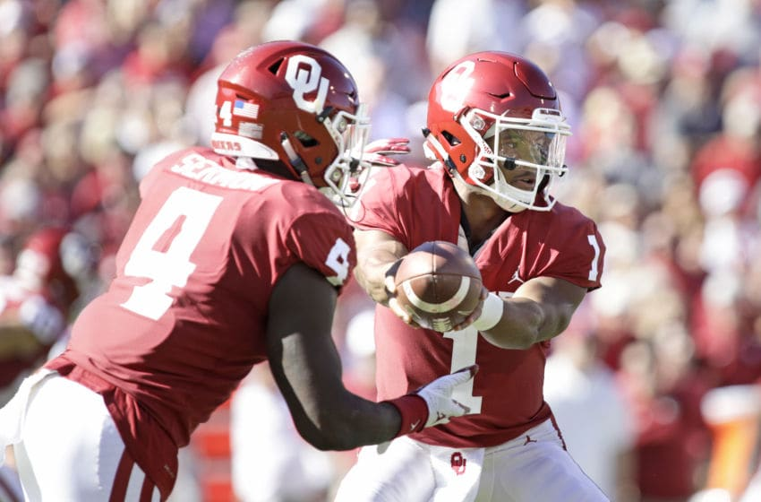 NORMAN, OK - OCTOBER 27: Quarterback Kyler Murray #1 hands off to running back Trey Sermon #4 of the Oklahoma Sooners during the game against the Kansas State Wildcats at Gaylord Family Oklahoma Memorial Stadium on October 27, 2018 in Norman, Oklahoma. Oklahoma defeated Kansas State 51-14. (Photo by Brett Deering/Getty Images)