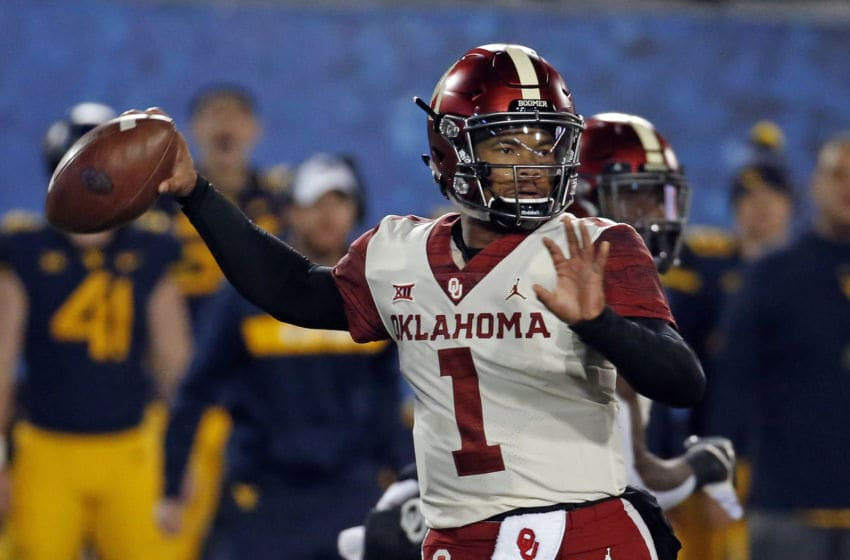MORGANTOWN, WV - NOVEMBER 23: Kyler Murray #1 of the Oklahoma Sooners passes in the first half against the West Virginia Mountaineers on November 23, 2018 at Mountaineer Field in Morgantown, West Virginia. (Photo by Justin K. Aller/Getty Images)