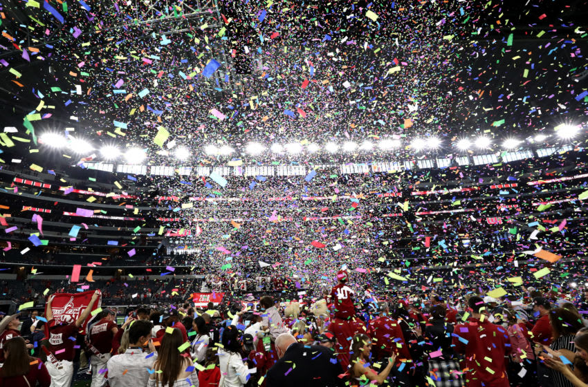 ARLINGTON, TEXAS - DECEMBER 01: The Oklahoma Sooners celebrate a 39-27 Big 12 Championship win against the Texas Longhorns at AT&T Stadium on December 01, 2018 in Arlington, Texas. (Photo by Ronald Martinez/Getty Images)