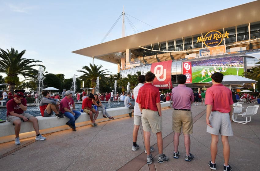 MIAMI, FL - DECEMBER 29: Fans outside watching the Cotton Bowl before the College Football Playoff Semifinal at the Capital One Orange Bowl at Hard Rock Stadium on December 29, 2018 in Miami, Florida. (Photo by Mark Brown/Getty Images)