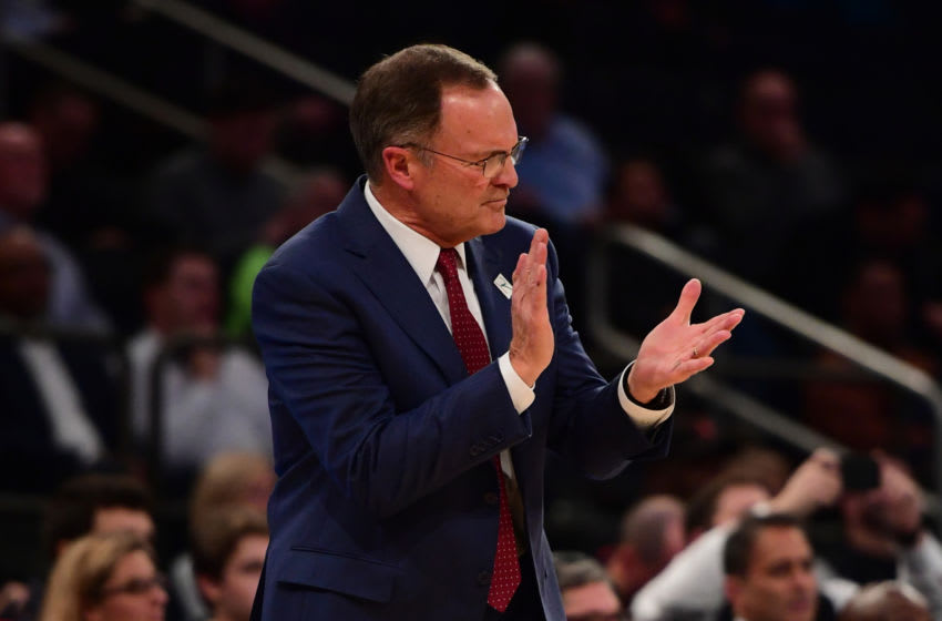 NEW YORK, NEW YORK - DECEMBER 04: Oklahoma Sooners head coach Lon Kruger claps during the first half of the game against Notre Dame Fighting Irish at Madison Square Garden on December 04, 2018 in New York City. (Photo by Sarah Stier/Getty Images)