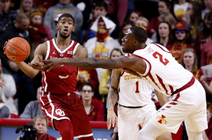 AMES, IA - FEBRUARY 25: Christian James #0 of the Oklahoma Sooners passes the ball as Cameron Lard #2 of the Iowa State Cyclones puts pressure on in the first half of play at Hilton Coliseum on February 25, 2019 in Ames, Iowa. (Photo by David Purdy/Getty Images)