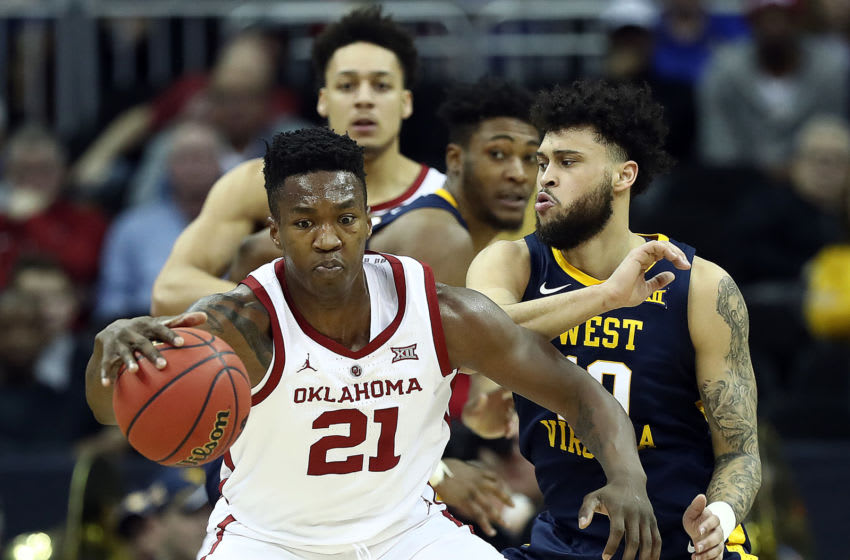 KANSAS CITY, MISSOURI - MARCH 13: Kristian Doolittle #21 of the Oklahoma Sooners controls the ball during the first round game of the Big 12 Basketball Tournament against the West Virginia Mountaineers at the Sprint Center on March 13, 2019 in Kansas City, Missouri. (Photo by Jamie Squire/Getty Images)