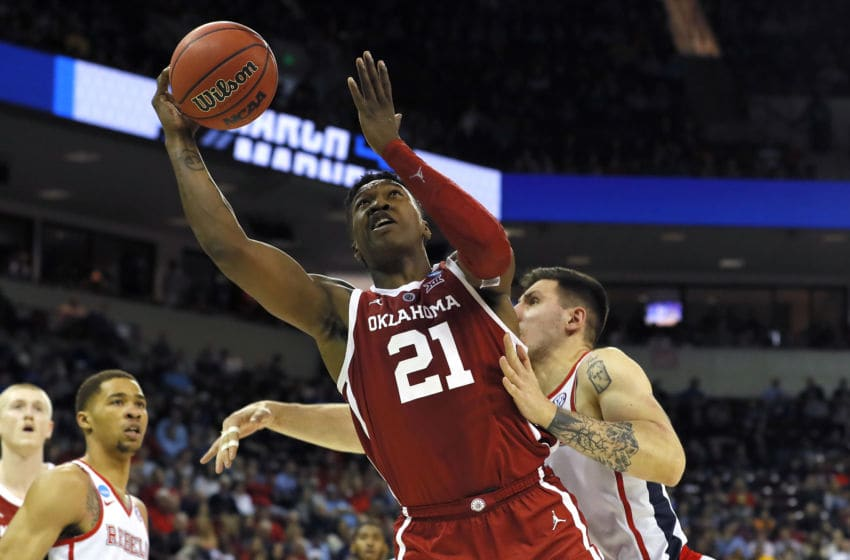 COLUMBIA, SOUTH CAROLINA - MARCH 22: Kristian Doolittle #21 of the Oklahoma Sooners drives to the basket against Dominik Olejniczak #13 of the Mississippi Rebels in the second half during the first round of the 2019 NCAA Men's Basketball Tournament at Colonial Life Arena on March 22, 2019 in Columbia, South Carolina. (Photo by Kevin C. Cox/Getty Images)