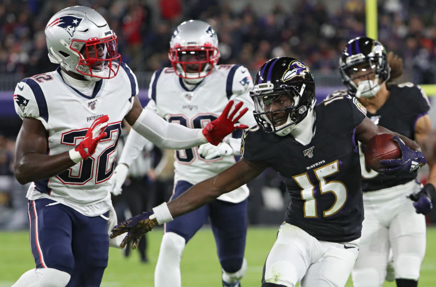 BALTIMORE, MARYLAND - NOVEMBER 03: Wide receiver Marquise Brown #15 of the Baltimore Ravens eludes safety Devin McCourty #32 of the New England Patriots during the first quarter at M&T Bank Stadium on November 3, 2019 in Baltimore, Maryland. (Photo by Todd Olszewski/Getty Images)