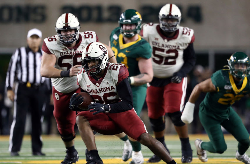 WACO, TEXAS - NOVEMBER 16: Kennedy Brooks #26 of the Oklahoma Sooners runs the ball against the Baylor Bears in the second half at McLane Stadium on November 16, 2019 in Waco, Texas. (Photo by Ronald Martinez/Getty Images)