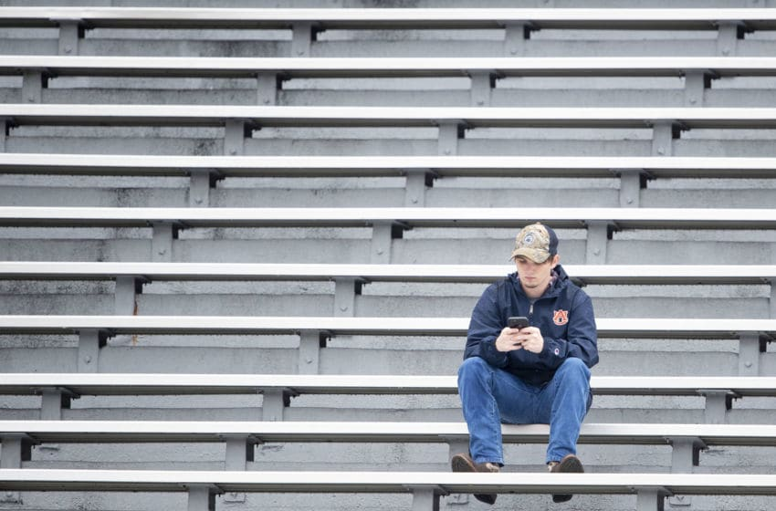 AUBURN, AL - NOVEMBER 23: An Auburn Tigers fan in the stands prior to their game against the Samford Bulldogs at Jordan-Hare Stadium on November 23, 2019 in Auburn, Alabama. (Photo by Michael Chang/Getty Images)